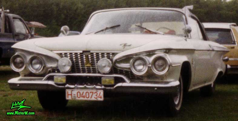 Photo of a white 1961 Chrysler Plymouth Fury Convertible at a classic car meeting in K�ln Chorweiler (Cologne), Germany. 1961 Plymouth Convertible