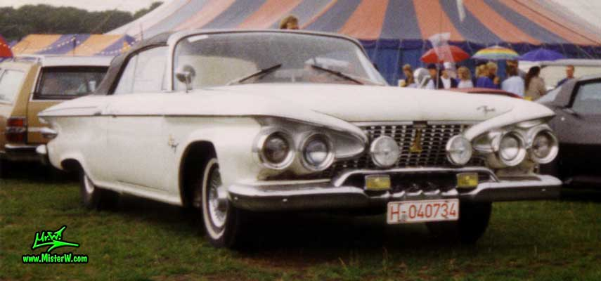 Photo of a white 1961 Chrysler Plymouth Fury Convertible at a classic car meeting in Köln Chorweiler (Cologne), Germany. Frontview of a white 1961 Plymouth Fury Convertible