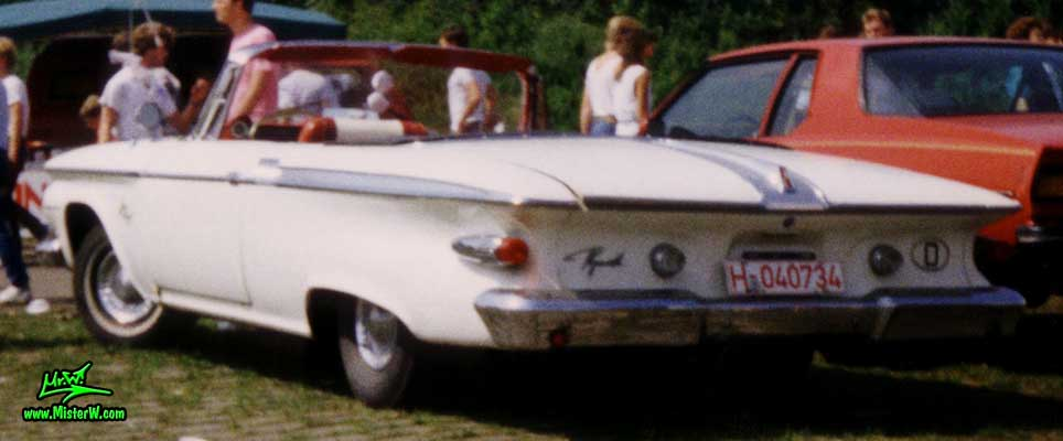 Photo of a white 1961 Chrysler Plymouth Fury Convertible at a classic car meeting in K�ln Chorweiler (Cologne), Germany. Rearview of a white 1961 Plymouth Fury Convertible