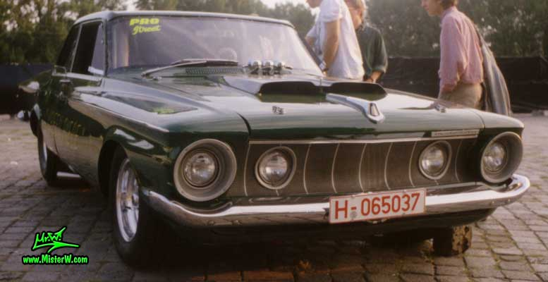 Photo of a dark green 1962 Chrysler Plymouth 2 Door Hardtop Coupe at a classic car meeting in Germany. 1962 Plymouth Coupe