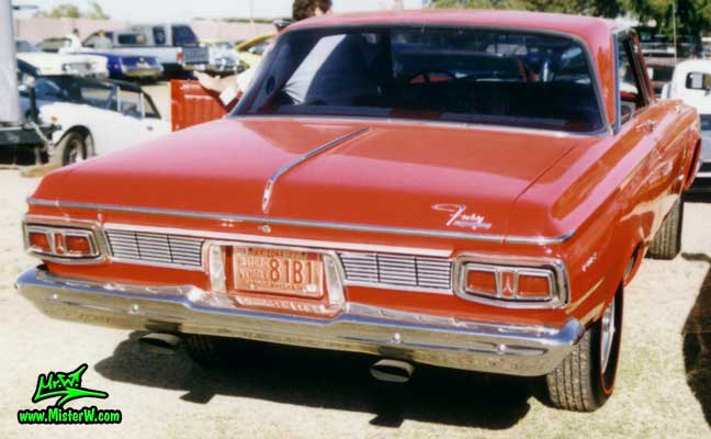 Photo of a red 1964 Chrysler Plymouth Fury 2 Door Hardtop Coupe at a classic car auction in Arizona. Rearview of a 1964 Plymouth Fury Coupe