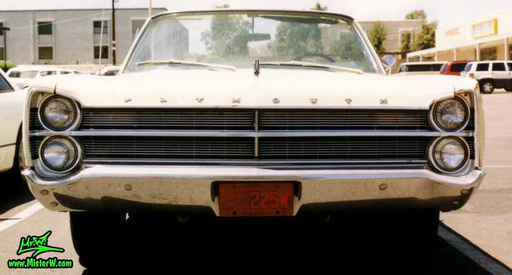 Photo of a white 1967 Chrysler Plymouth Sport Fury Convertible in Sunnyslope, Arizona. Chrome Grill of a 1967 Plymouth Sport Fury Convertible