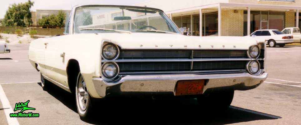 Photo of a white 1967 Chrysler Plymouth Sport Fury Convertible in Sunnyslope, Arizona. Frontview of a 1967 Plymouth Sport Fury Convertible
