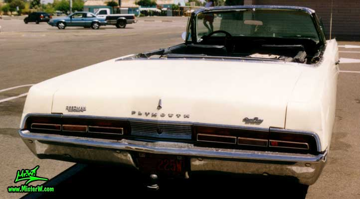Photo of a white 1967 Chrysler Plymouth Sport Fury Convertible in Sunnyslope, Arizona. Rearview of a 1967 Plymouth Sport Fury Convertible