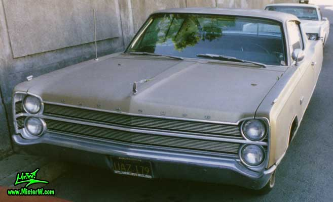 Photo of a gold brown 1967 Chrysler Plymouth 2 Door Hardtop Coupe in San Francisco, California. 1967 Plymouth