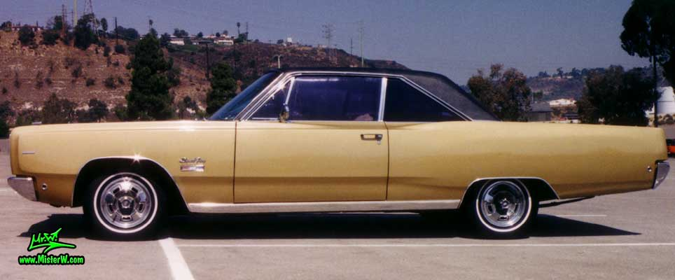 Photo of a gold brown 1968 Chrysler Plymouth Sport Fury 2 Door Hardtop Coupe at the San Diego Auto Swap & Show at the Qualcomm Stadium. Sideview of a 1968 Plymouth Sport Fury Coupe
