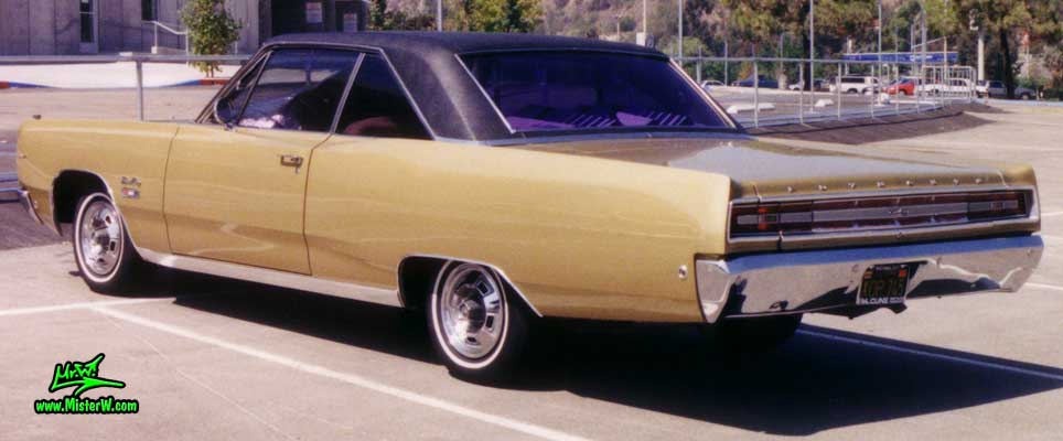 Photo of a gold brown 1968 Chrysler Plymouth Sport Fury 2 Door Hardtop Coupe at the San Diego Auto Swap & Show at the Qualcomm Stadium. Rearview of a 1968 Plymouth Sport Fury Coupe