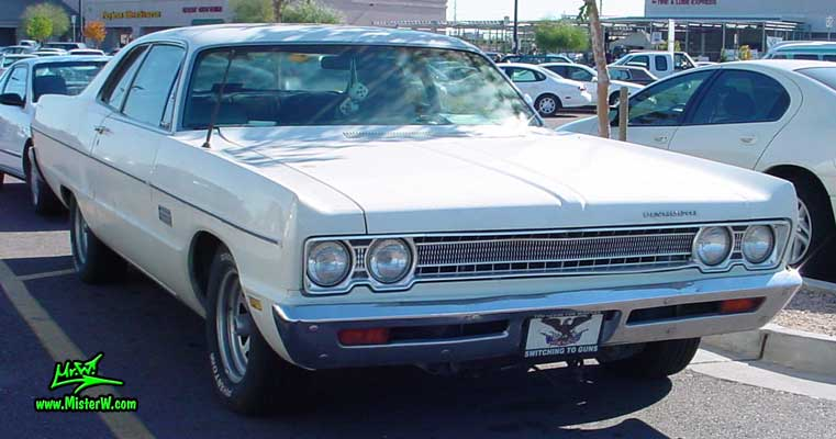 Photo of a white 1969 Chrysler Plymouth 2 Door Hardtop Coupe at a classic car meeting in Arizona. 1969 Plymouth Coupe