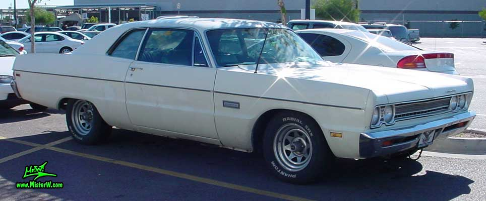 Photo of a white 1969 Chrysler Plymouth 2 Door Hardtop Coupe at a classic car meeting in Arizona. White Fuselage Style 1969 Plymouth Coupe
