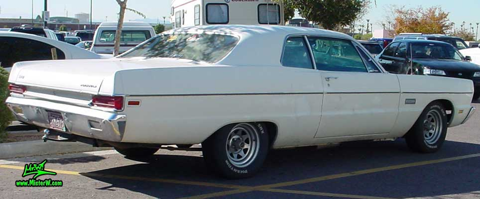 Photo of a white 1969 Chrysler Plymouth 2 Door Hardtop Coupe at a classic car meeting in Arizona. Sideview of a 1969 Plymouth Coupe