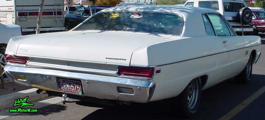 Photo of a white 1969 Chrysler Plymouth 2 Door Hardtop Coupe at a classic car meeting in Arizona. Rearview of a 1969 Plymouth Coupe
