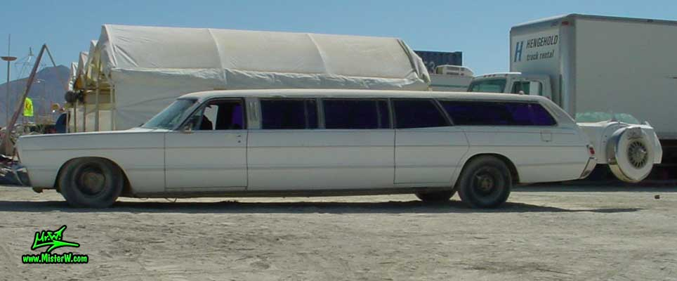 Photo of a white 1969 Chrysler Plymouth Strech Limo Wagon at the Burning Man Festival in Black Rock City, Nevada. Streched 1969 Plymouth Wagon