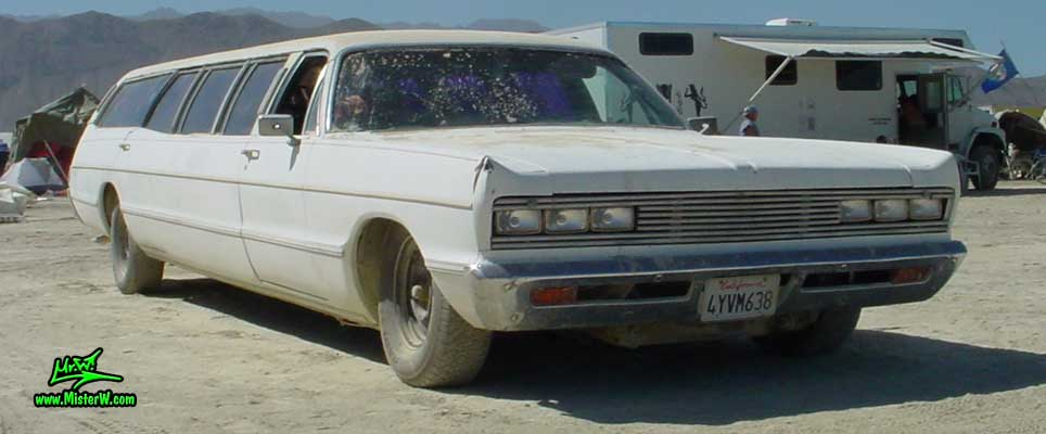 Photo of a white 1969 Chrysler Plymouth Strech Limo Wagon at the Burning Man Festival in Black Rock City, Nevada. 1969 Plymouth Stretch Limo Wagon