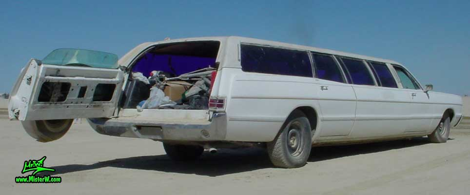Photo of a white 1969 Chrysler Plymouth Strech Limo Wagon at the Burning Man Festival in Black Rock City, Nevada. Extra Long 1969 Plymouth Stationwagon