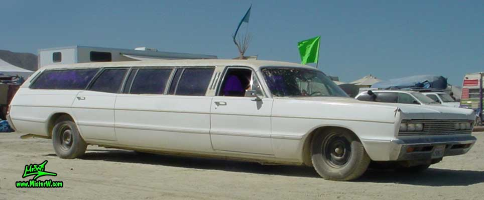 Photo of a white 1969 Chrysler Plymouth Strech Limo Wagon at the Burning Man Festival in Black Rock City, Nevada. 1969 Plymouth Stretch Wagon