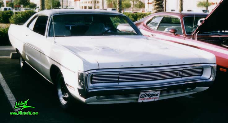 Photo of a white 1970 Chrysler Plymouth 2 Door Hardtop Coupe at the Scottsdale Pavilions Classic Car Show in Arizona. 1970 Plymouth Coupe