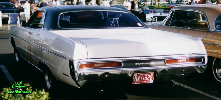 Photo of a white 1970 Chrysler Plymouth 2 Door Hardtop Coupe at the Scottsdale Pavilions Classic Car Show in Arizona. Back of a 1970 Plymouth Coupe