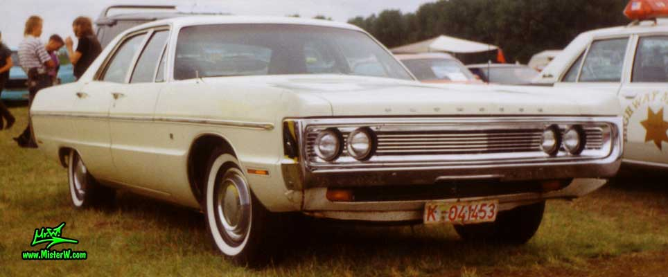 Photo of a white 1970 Chrysler Plymouth 4 Door Hardtop Sedan at a classic car meeting in Germany. Front of a 1970 Plymouth Sedan