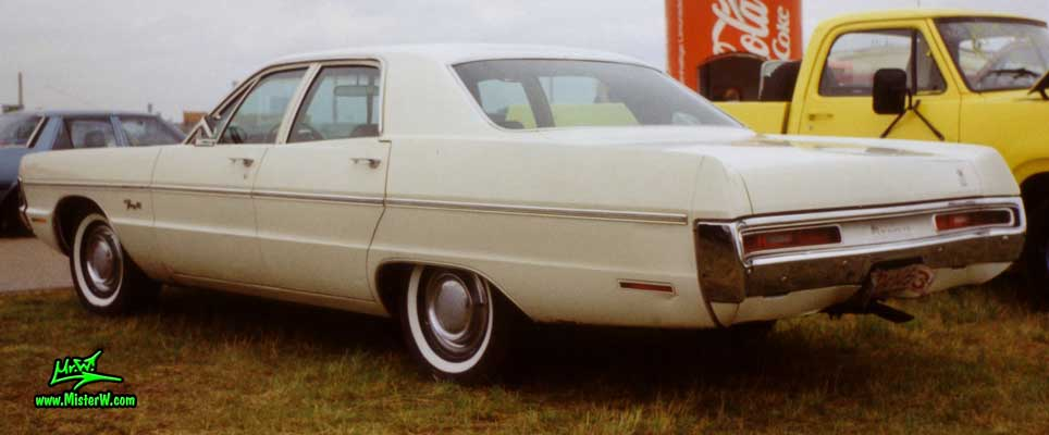 Photo of a white 1970 Chrysler Plymouth 4 Door Hardtop Sedan at a classic car meeting in Germany. Rearview of a 1970 Plymouth Sedan