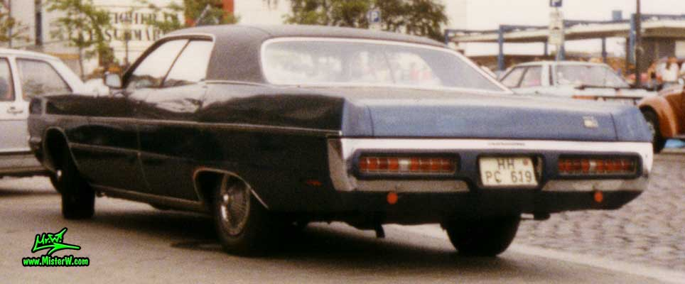 Photo of a blue 1971 Chrysler Plymouth Fury 4 Door Hardtop Sedan at a classic car meeting on the St. Pauli Fischmarkt in Hamburg, Germany. Fuselage Styled 1971 Plymouth Fury Sedan