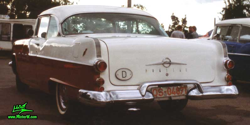 Photo of a red & white 1955 Pontiac 2 Door Hardtop Coupe at a Classic Car Meeting in Germany. Rearview of a 1955 Pontiac