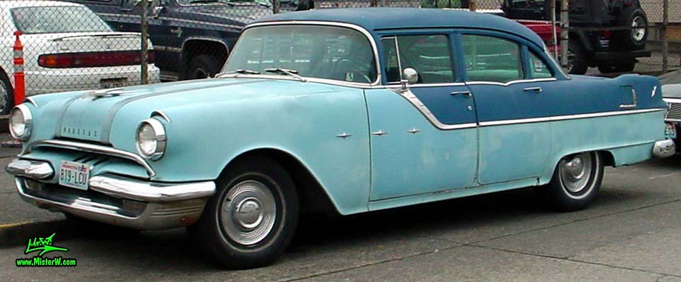 Photo of a bright & dark blue 1955 Pontiac 4 Door Sedan in downtown Seattle, Washington. 1955 Pontiac
