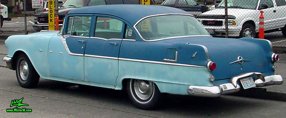 Photo of a bright & dark blue 1955 Pontiac 4 Door Sedan in downtown Seattle, Washington. 55 Pontiac