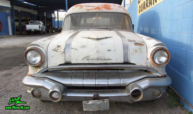 Photo of a grey primered 1956 Pontiac ambulance in Phoenix, Arizona. Front view of a 56 Pontiac Ambulance Wagon