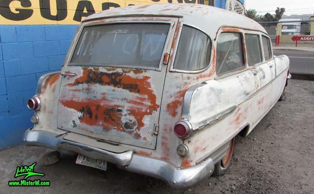 Photo of a grey primered 1956 Pontiac ambulance in Phoenix, Arizona. Rear corner of a 56 Pontiac Ambulance Wagon