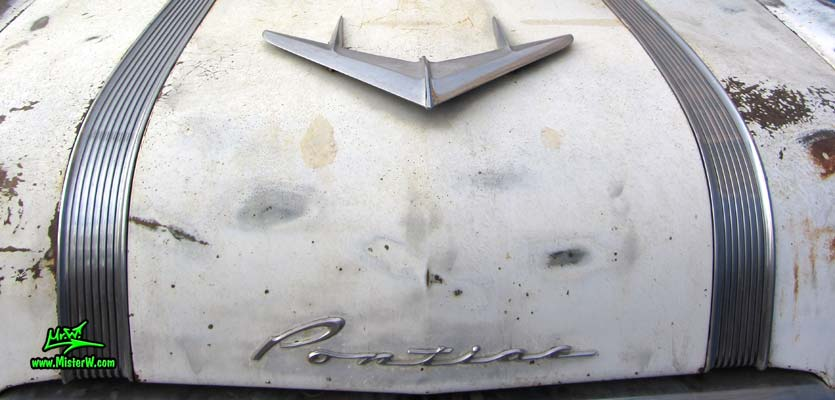 Photo of a grey primered 1956 Pontiac ambulance in Phoenix, Arizona. Hood of a 56 Pontiac Ambulance Wagon