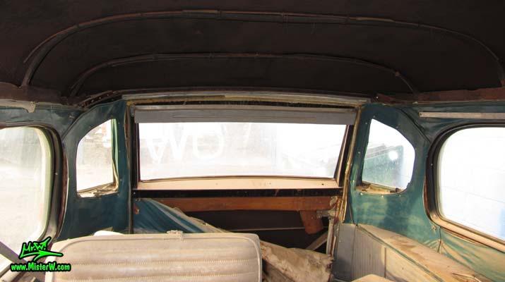 Photo of a grey primered 1956 Pontiac ambulance in Phoenix, Arizona. Rear windows of a 56 Pontiac Ambulance Wagon