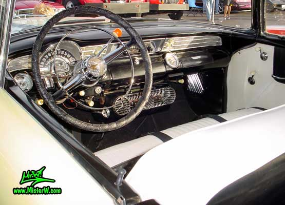 Photo of a jade & white 1956 Pontiac 2 Door Hardtop Coupe at the Scottsdale Pavilions Classic Car Show in Arizona. 1956 Pontiac Odometer & Dash Board