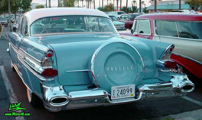 Photo of a blue 1957 Pontiac 2 Door Hardtop Coupe at the Scottsdale Pavilions Classic Car Show in Arizona. 1957 Pontiac Rearview