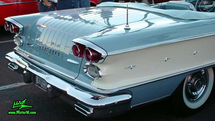 Photo of a blue 1958 Pontiac Bonneville 2 Door Convertible at the Scottsdale Pavilions Classic Car Show in Arizona. 1958 Bonneville Fins & Tail Lights