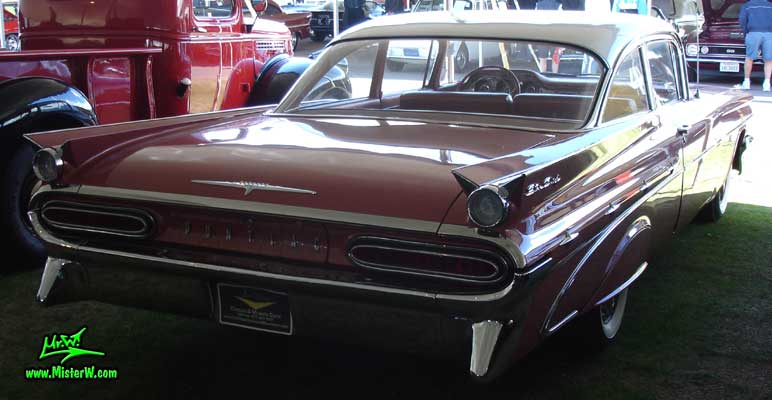 Photo of a pink 1959 Pontiac Star Chief 2 Door Hardtop Coupe at a Classic Car Auction in Scottsdale, Arizona. 1959 Pontiac Star Chief Sideview