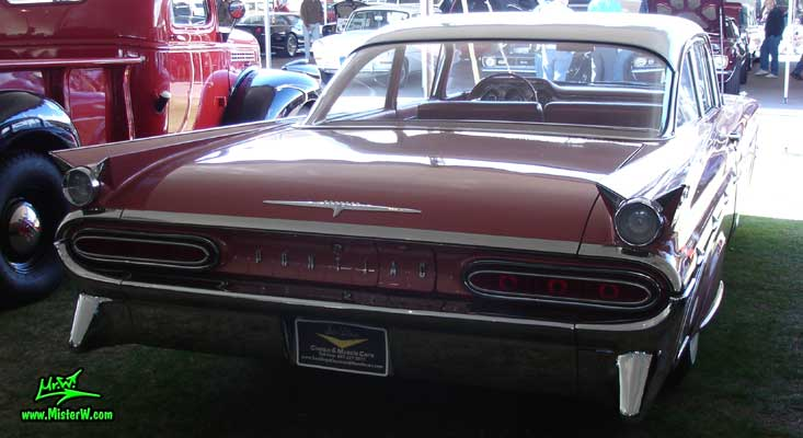 Photo of a pink 1959 Pontiac Star Chief 2 Door Hardtop Coupe at a Classic Car Auction in Scottsdale, Arizona. 1959 Pontiac Star Chief Rearview