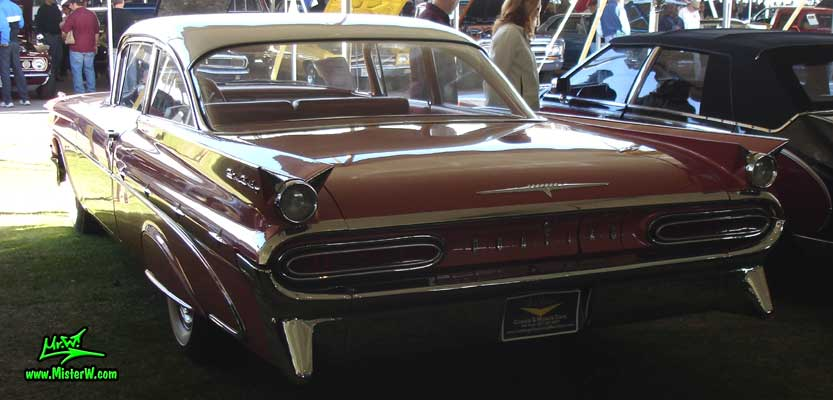 Photo of a pink 1959 Pontiac Star Chief 2 Door Hardtop Coupe at a Classic Car Auction in Scottsdale, Arizona. 59 Pontiac Tail Fins & Chrome
