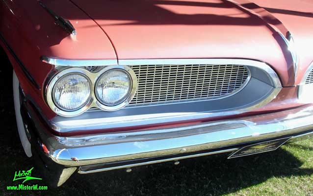 Photo of a pink 1959 Pontiac Star Chief 2 Door Hardtop Coupe at a Classic Car Auction in Scottsdale, Arizona. 59 Pontiac Head Lights & Chrome