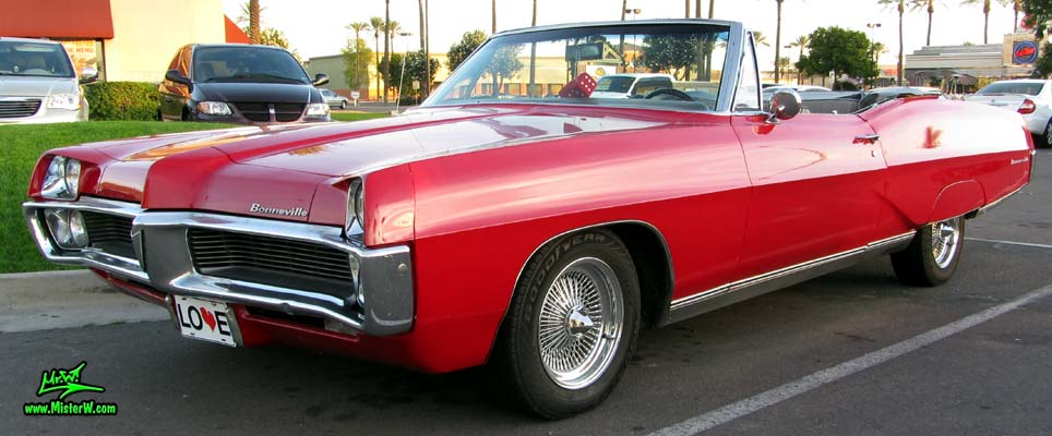 Photo of a red 1967 Pontiac Bonneville Convertible at the Scottsdale Pavilions Classic Car Show in Arizona. 67 Pontiac Convertible
