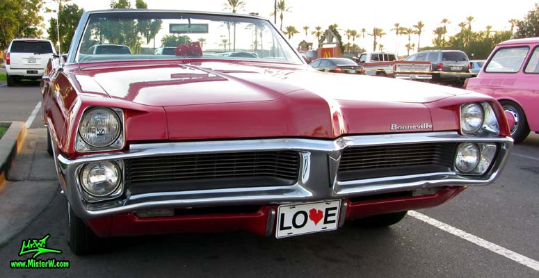 Photo of a red 1967 Pontiac Bonneville Convertible at the Scottsdale Pavilions Classic Car Show in Arizona. Beautiful Front Grill of a 67 Pontiac Bonneville Convertible