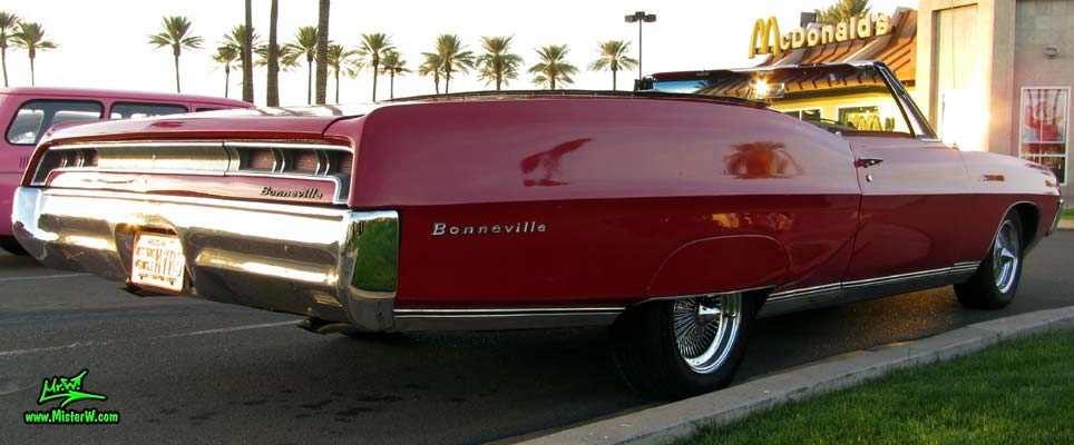 Photo of a red 1967 Pontiac Bonneville Convertible at the Scottsdale Pavilions Classic Car Show in Arizona. 1967 Pontiac Bonneville Convertible Coke Bottle Sidelines
