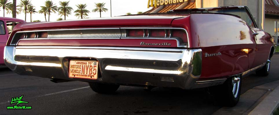 Photo of a red 1967 Pontiac Bonneville Convertible at the Scottsdale Pavilions Classic Car Show in Arizona. 1967 Pontiac Bonneville Convertible Tail Lights & Rear Bumper