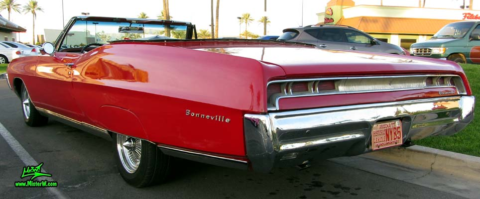 Photo of a red 1967 Pontiac Bonneville Convertible at the Scottsdale Pavilions Classic Car Show in Arizona. Rear & Tail Lights of a 67 Pontiac Convertible