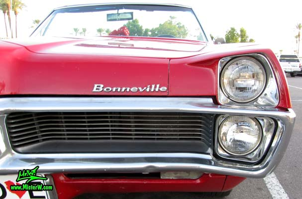 Photo of a red 1967 Pontiac Bonneville Convertible at the Scottsdale Pavilions Classic Car Show in Arizona. 1967 Pontiac Bonneville Convertible Front Grill
