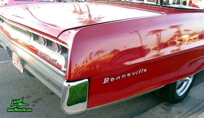 Photo of a red 1967 Pontiac Bonneville Convertible at the Scottsdale Pavilions Classic Car Show in Arizona. 67 Pontiac Bonneville Tail Light & Rear Bumper