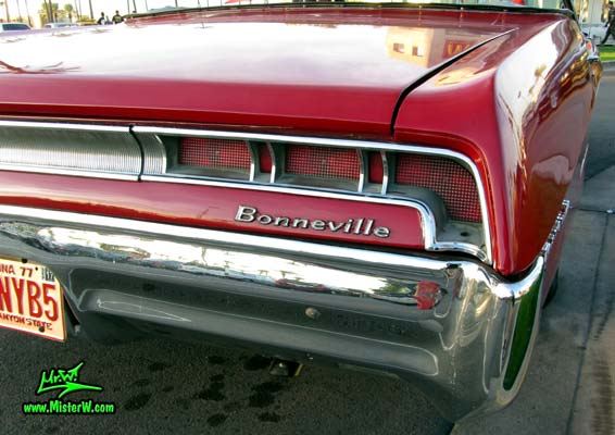 Photo of a red 1967 Pontiac Bonneville Convertible at the Scottsdale Pavilions Classic Car Show in Arizona. 1967 Pontiac Bonneville Convertible Tail Lights