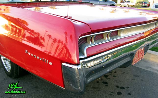 Photo of a red 1967 Pontiac Bonneville Convertible at the Scottsdale Pavilions Classic Car Show in Arizona. 1967 Pontiac Bonneville Convertible Rear Bumper Corner