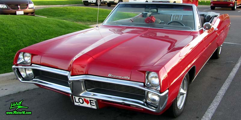 Photo of a red 1967 Pontiac Bonneville Convertible at the Scottsdale Pavilions Classic Car Show in Arizona. Agressive 67 Pontiac Bonneville Convertible Front Bumper