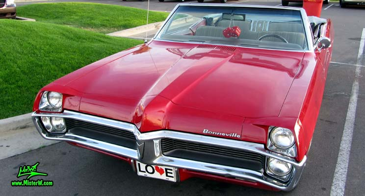 Photo of a red 1967 Pontiac Bonneville Convertible at the Scottsdale Pavilions Classic Car Show in Arizona. 1967 Pontiac Bonneville Convertible Double Front Bumper