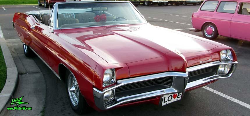 Photo of a red 1967 Pontiac Bonneville Convertible at the Scottsdale Pavilions Classic Car Show in Arizona. 1967 Pontiac Bonneville Cabrio